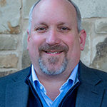 Head shot of the author for remote advancement services article